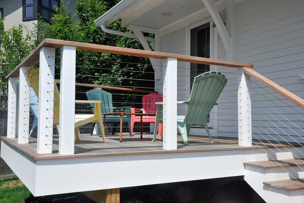 Colorful Adirondack chairs on a white deck