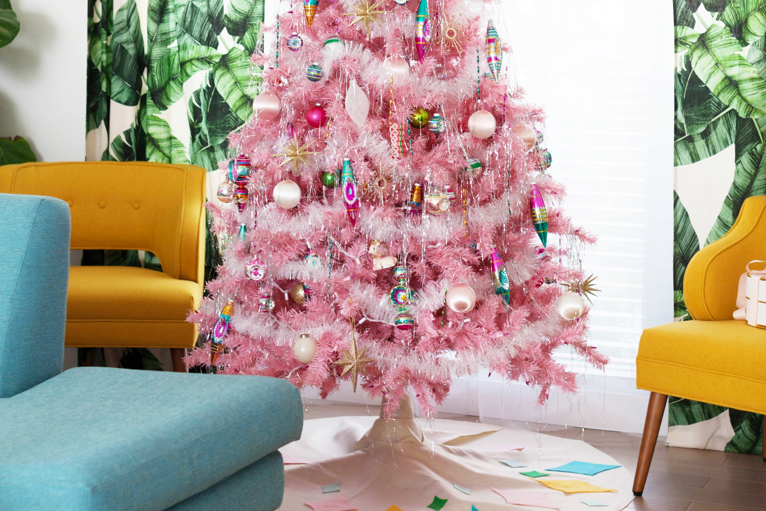 Pink aluminum Christmas tree in retro living room