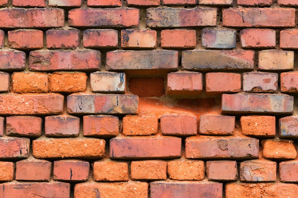 Red brick wall with four bricks missing | Home Equity Loans