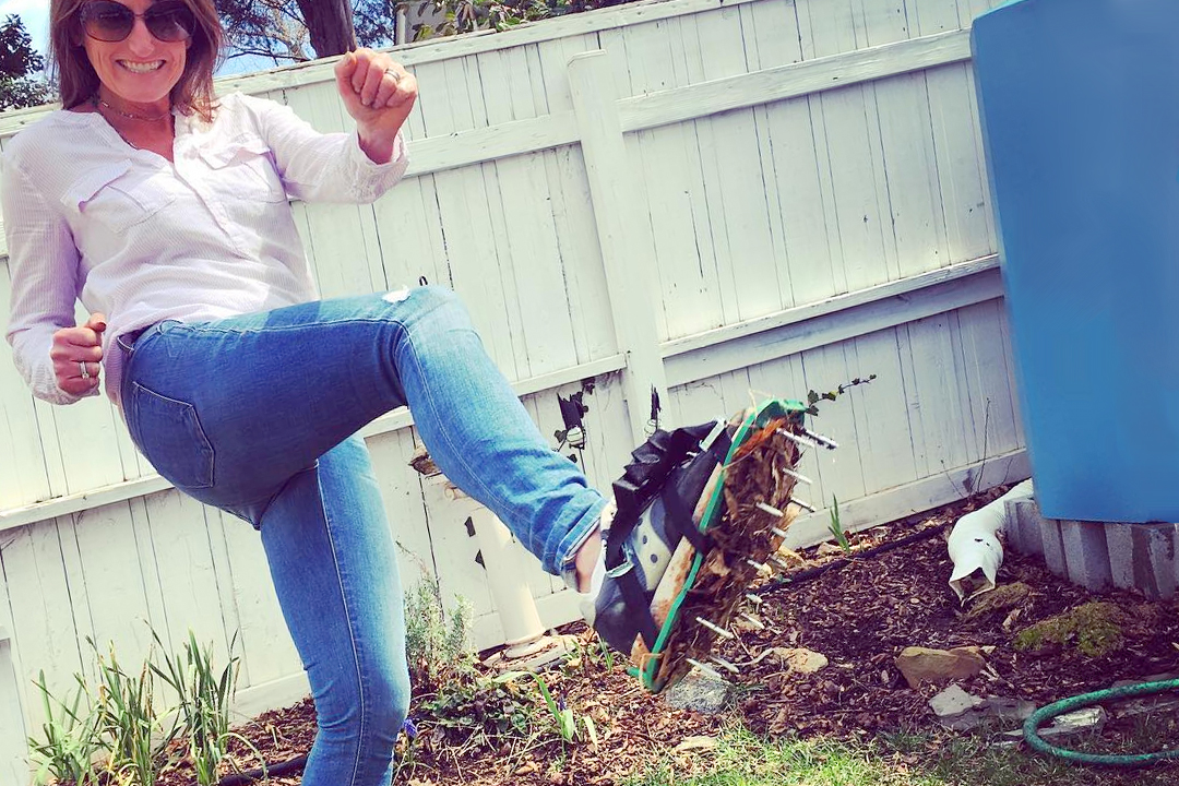 Woman aerating her lawn in spring