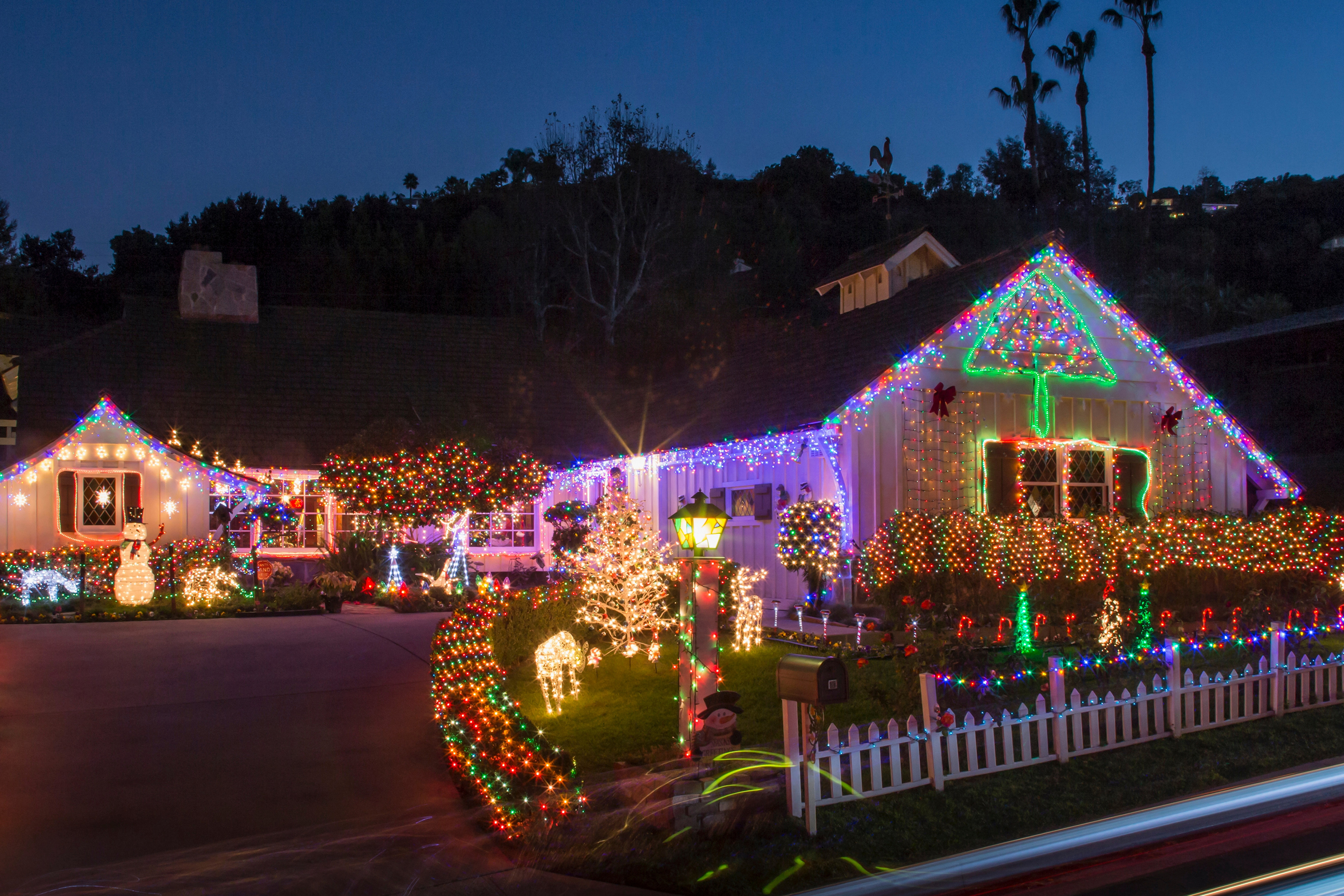 Brightly colored Christmas light display outside a home