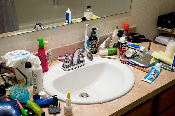 A cluttered bathroom sink