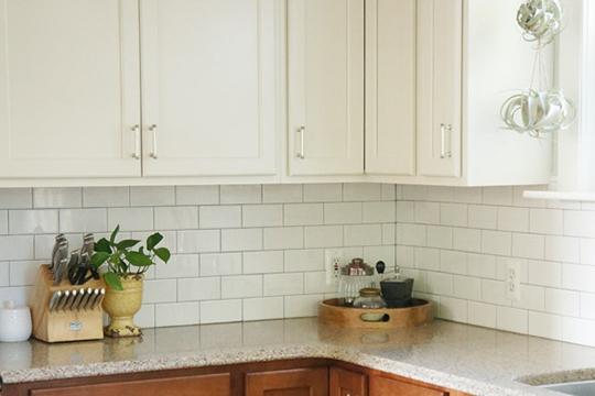 White subway tile kitchen backsplash