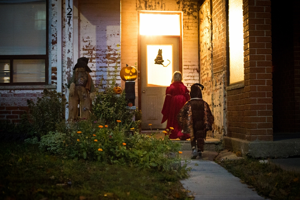 Trick or treat Halloween safety rules in a neighborhood