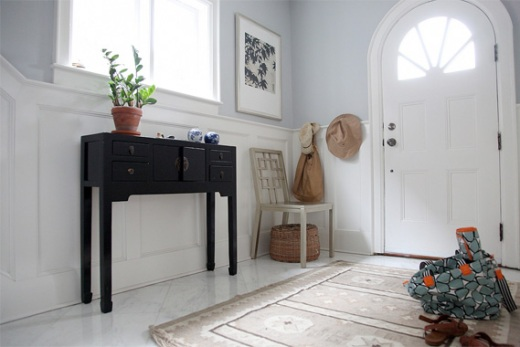 Foyer with side table, seating and coat hooks