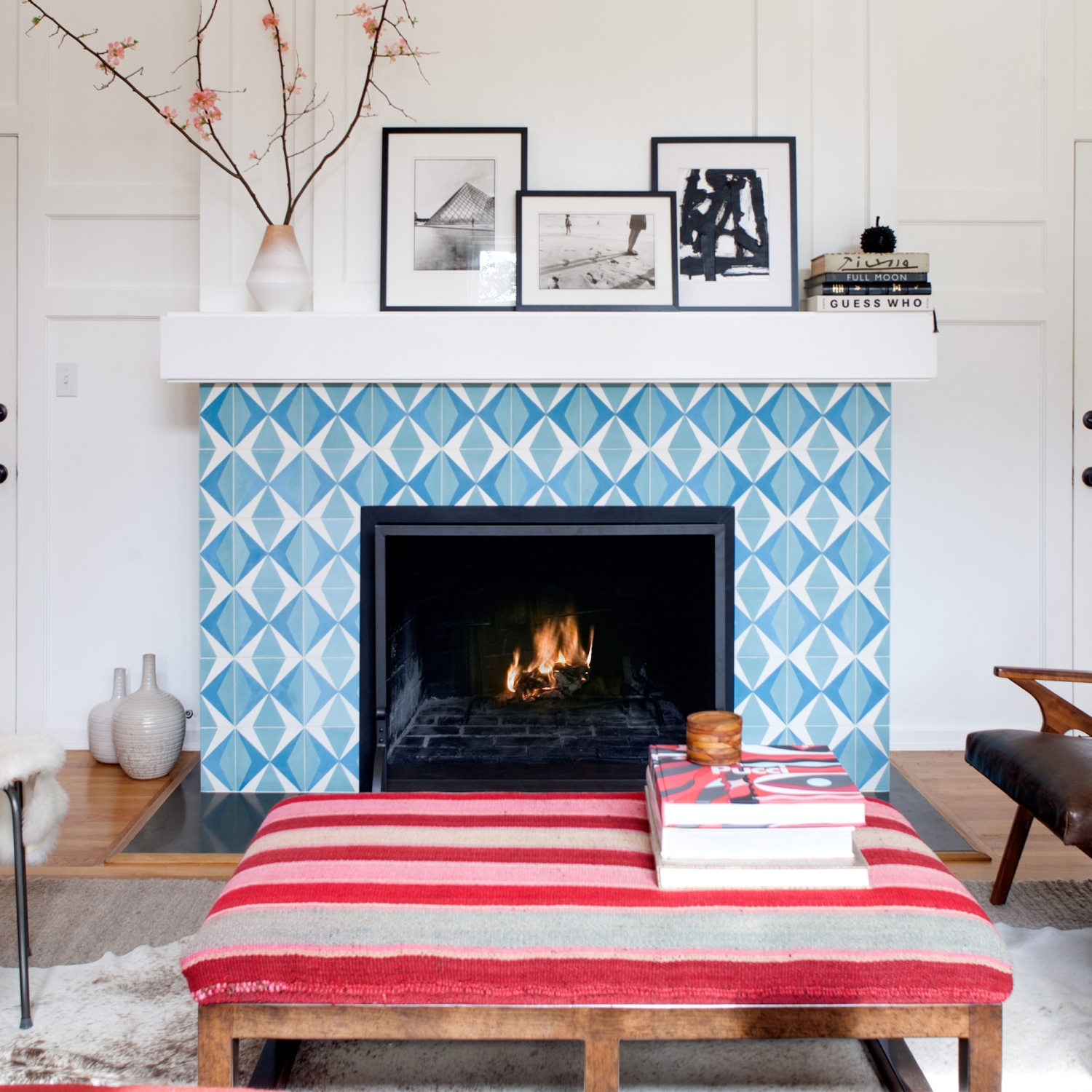 A blue and white tile fireplace in a living room