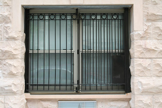 Decorative burglar bars on a window