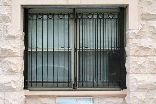 Decorative burglar bars on a window