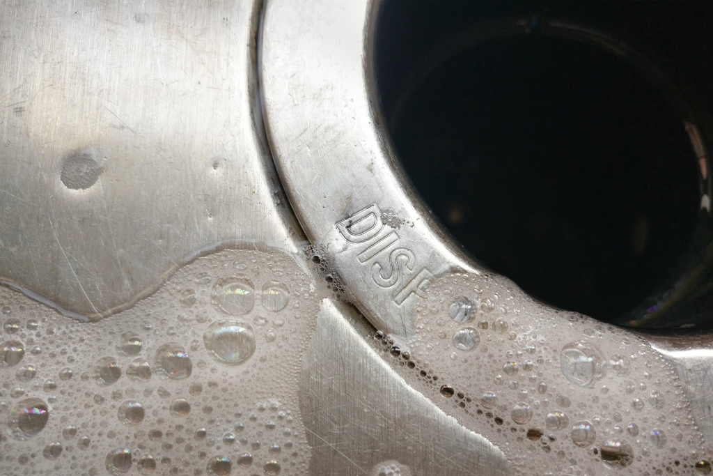 Closeup of a garbage disposal in a kitchen sink