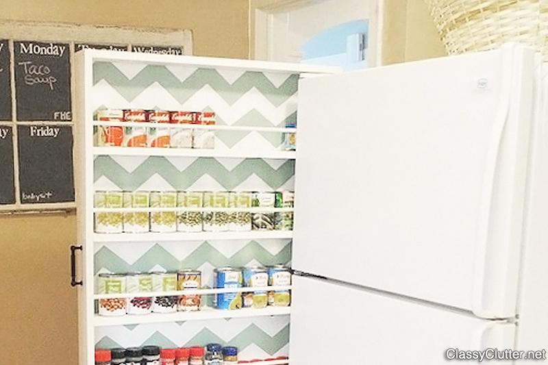 Space-saving can storage next to refrigerator
