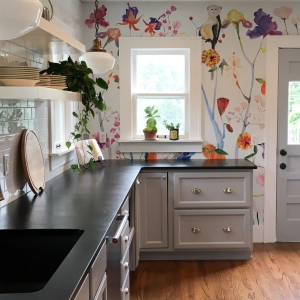 Gray Kitchen Counters Against Colorful Fl Wallpaper