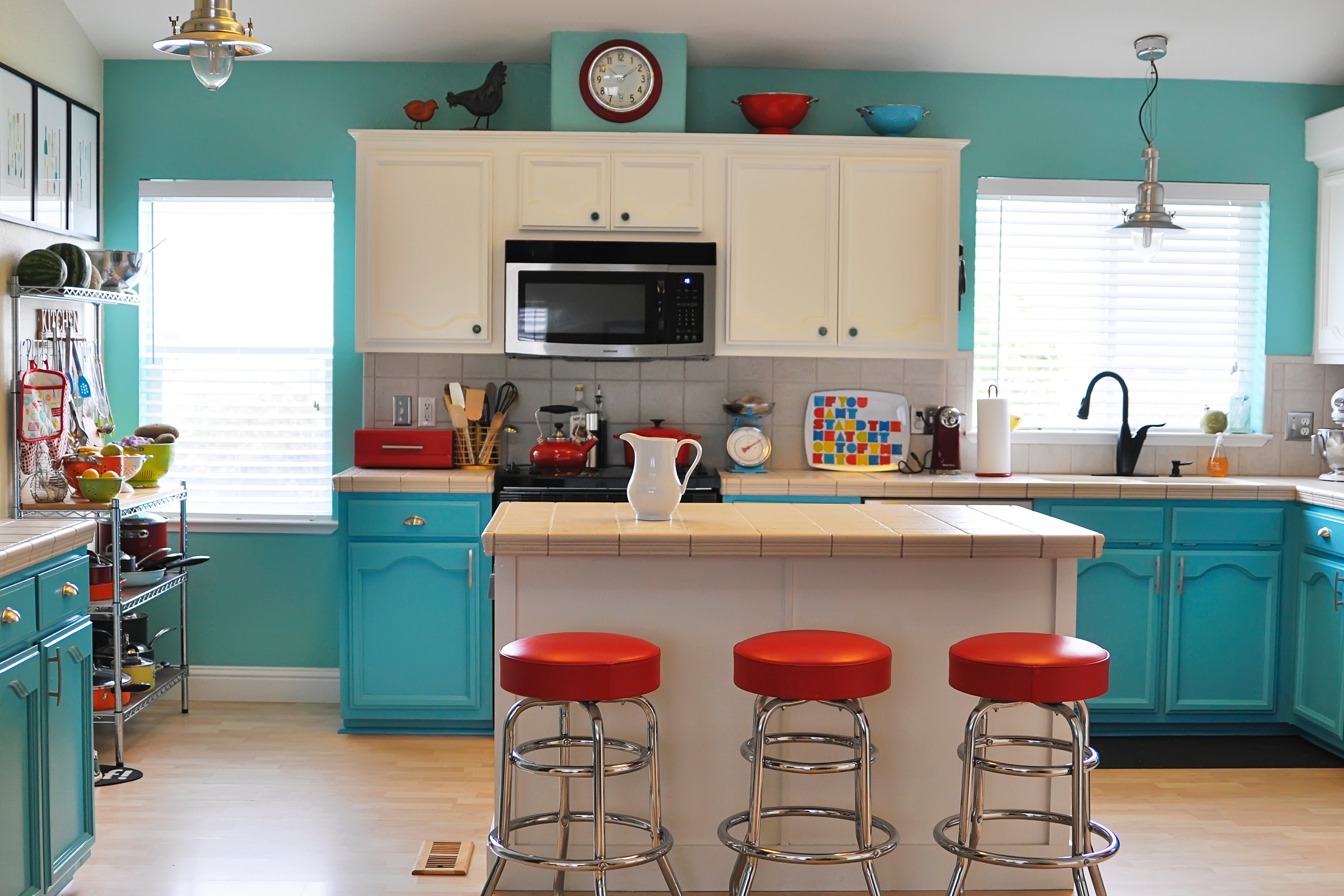 Colorfully painted kitchen with white cabinets