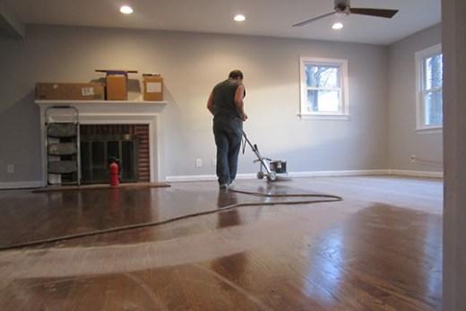 A pro refinishing hardwood floors