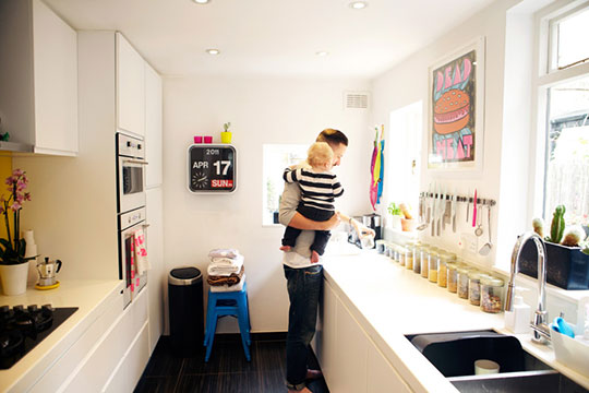 Colorful artwork in white kitchen
