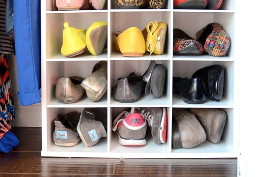 Shoes organized in a home closet