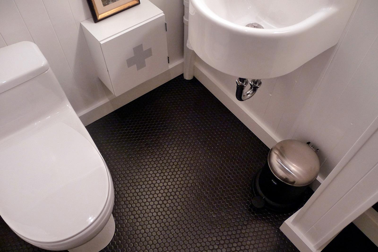 Anna's hip black penny tile bathroom floor