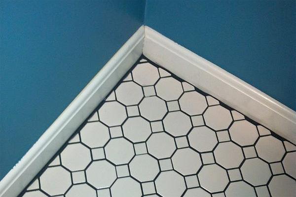 Tile Grout Showing at Baseboards | Bad Remodeling Jobs