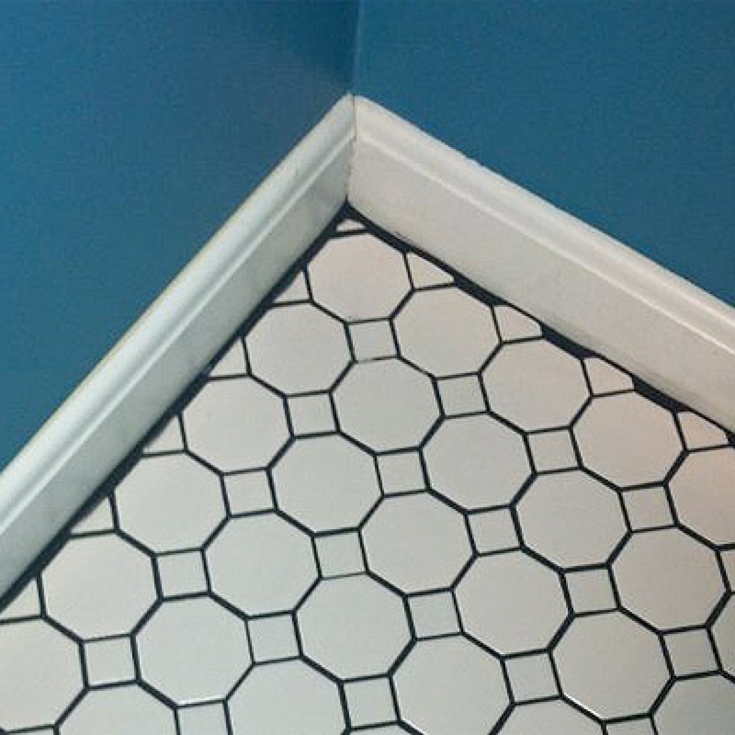 Tile Grout Showing at Baseboards | Bad Remodeling Jobs
