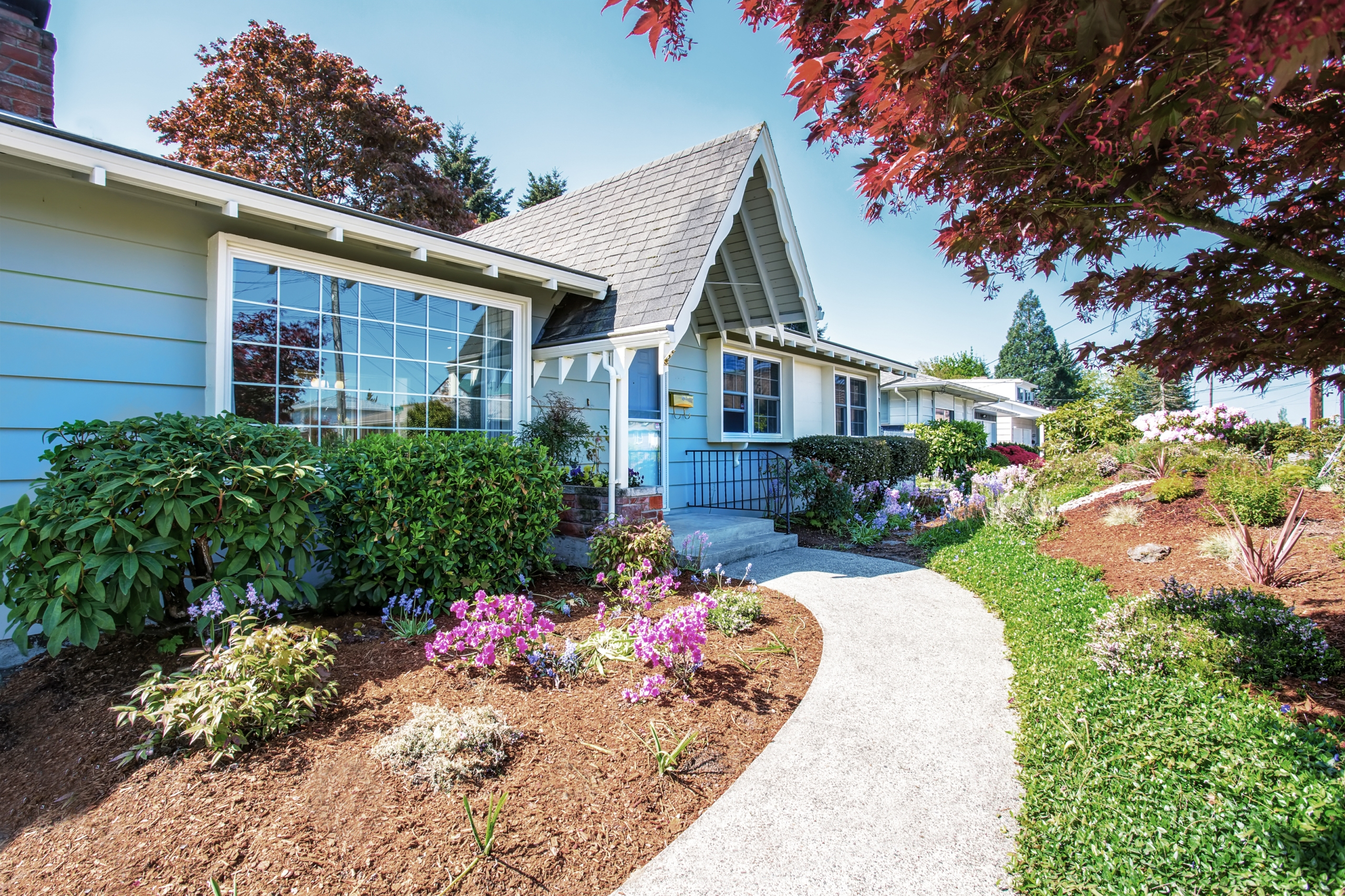 Home with lovely plantings for curb appeal