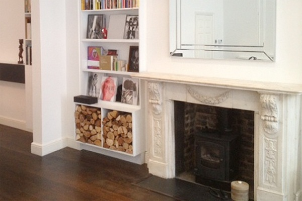 Fireplace with Wood Storage   Fireplace Surrounds
