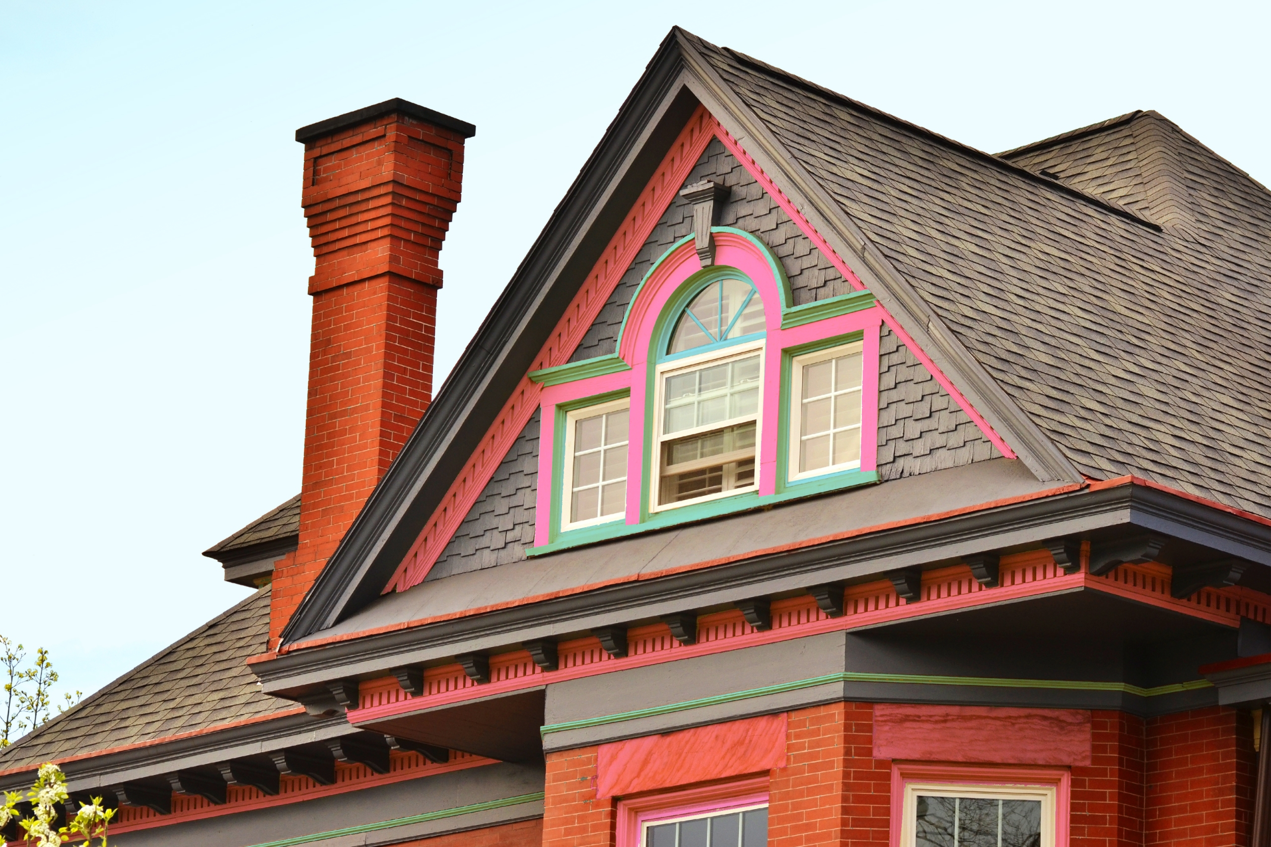 Brand new roof on house with pink and green detailing