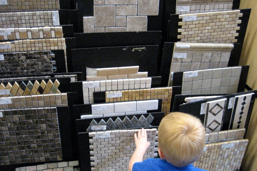 A child looking at tile flooring samples