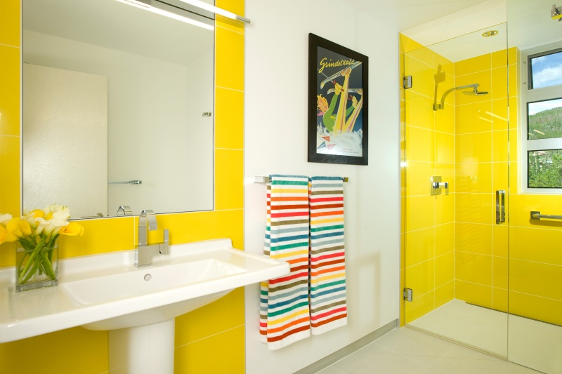 Yellow bathroom with walk-in shower