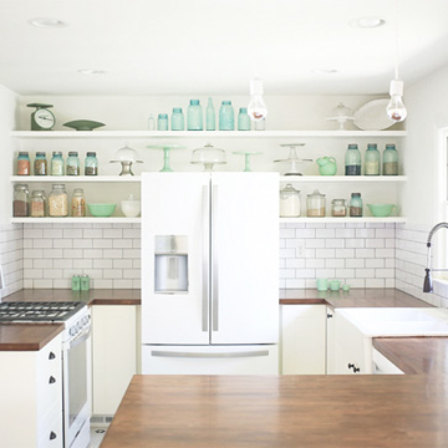 A kitchen with white appliances