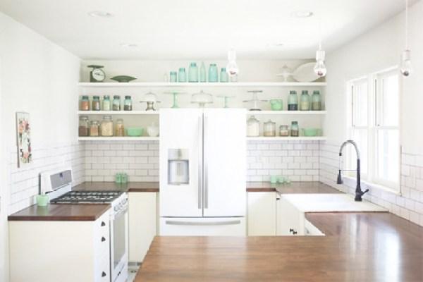 A kitchen with white appliances