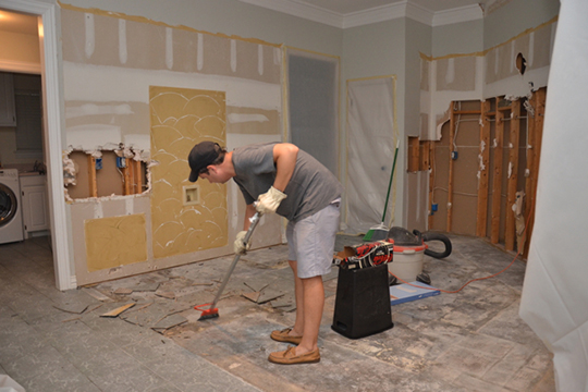Removing kitchen floor during a house remodel