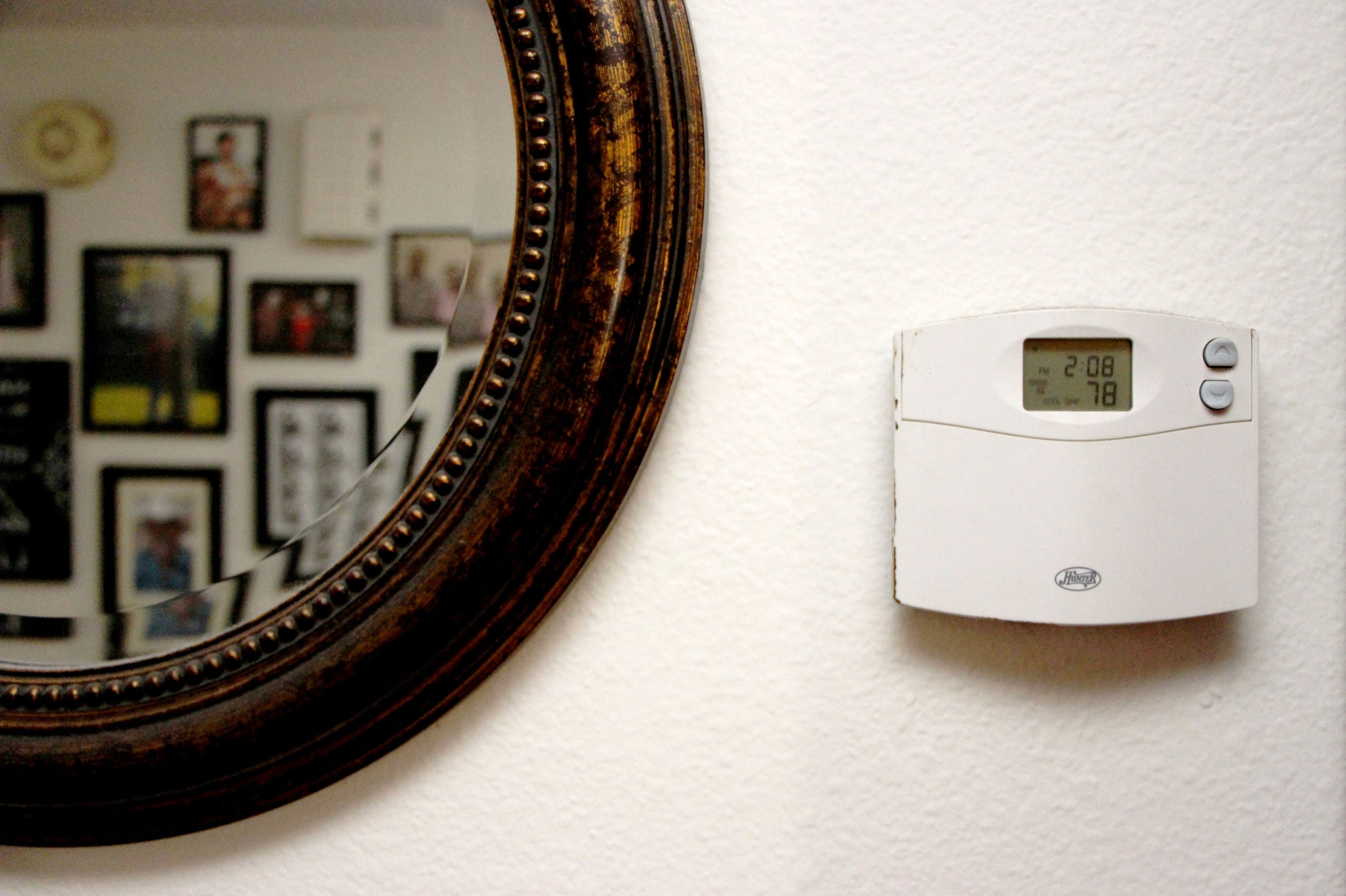 A thermostat on the wall of a home