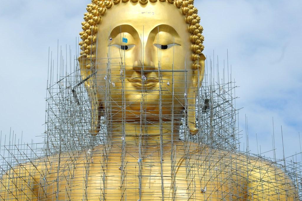 Buddha statue under renovation
