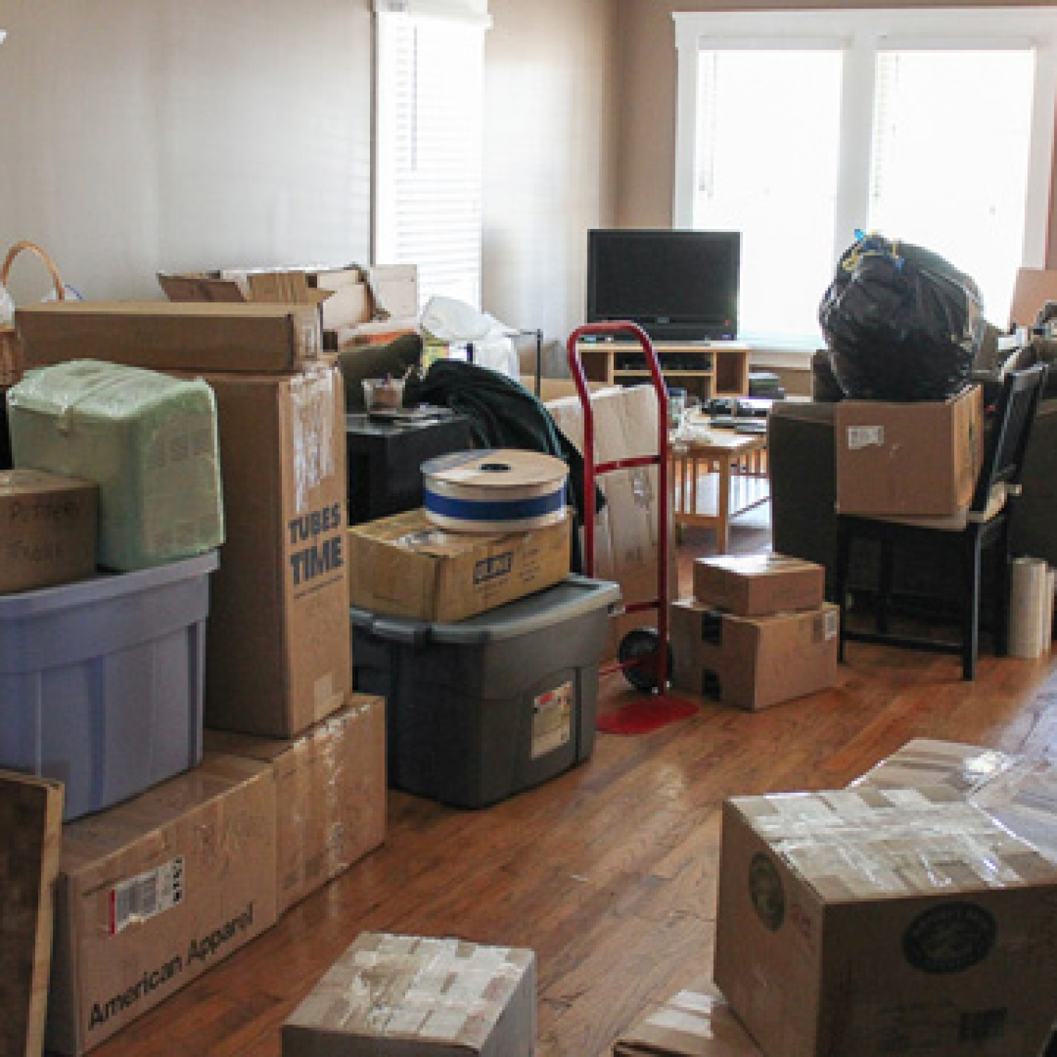Packed moving boxes in a home