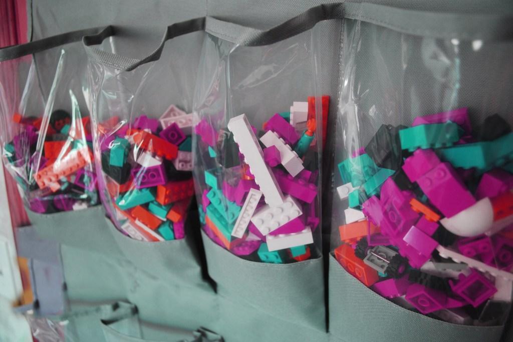 Legos stored in a shoe organizer