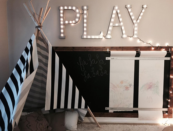 Chalkboard and paper rolls in a child's playroom