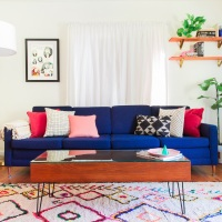 Stunning blue couch in home staged for sale
