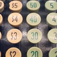Orange and green keys of a cash register