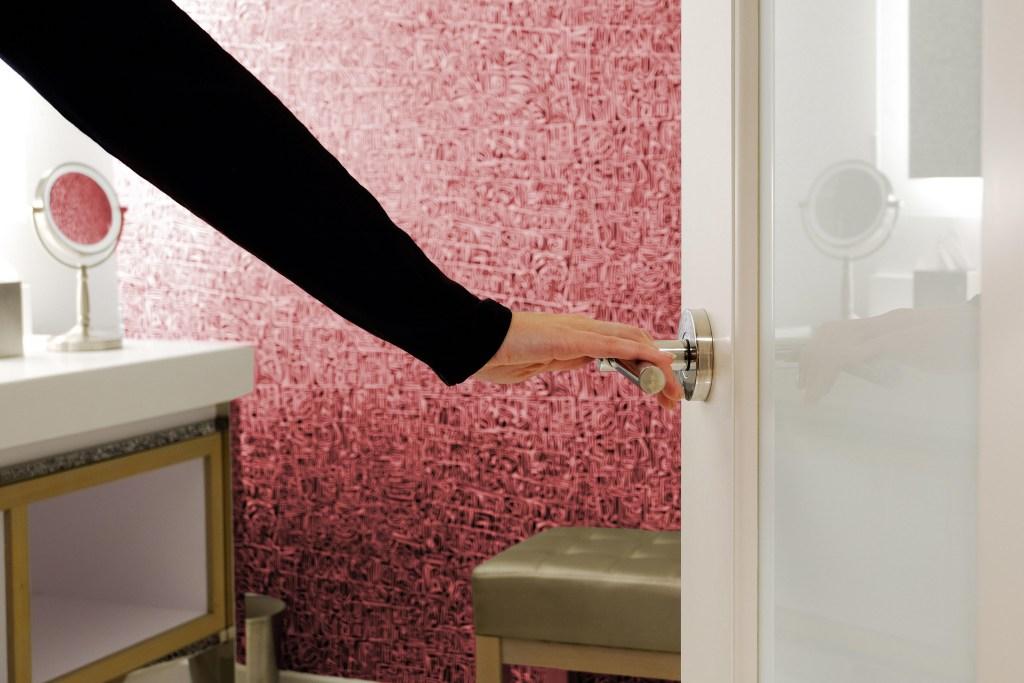 Opening a bathroom door at an open house