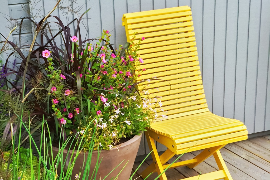 Yellow chair with potted plant