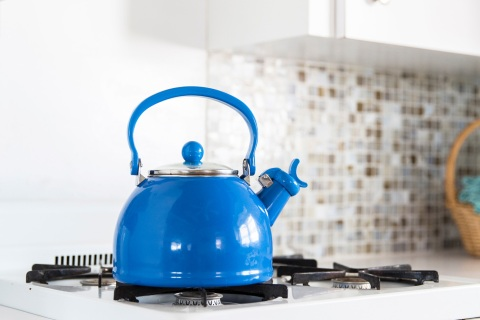 Blue tea kettle in a kitchen