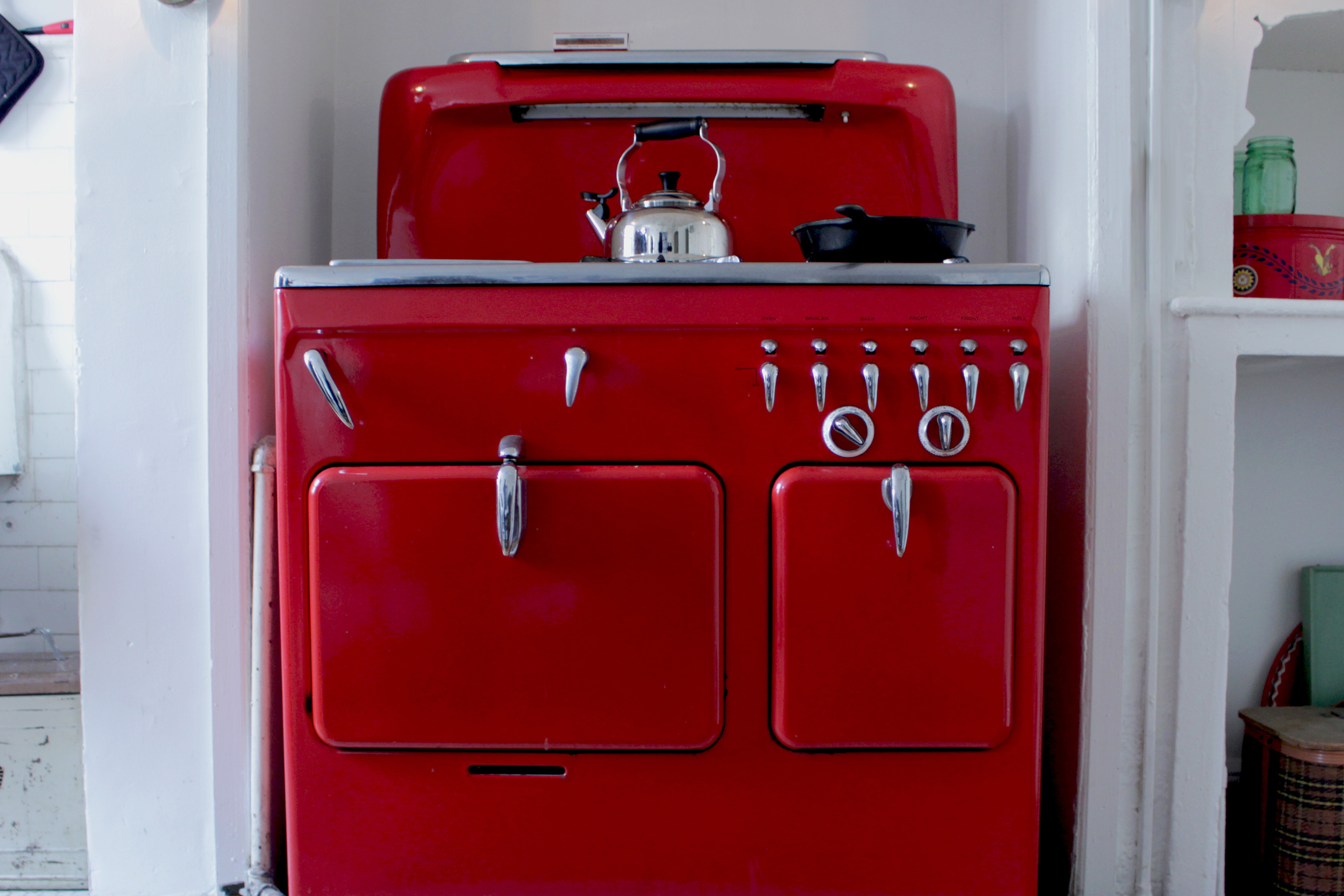 Red vintage stove in a home kitchen