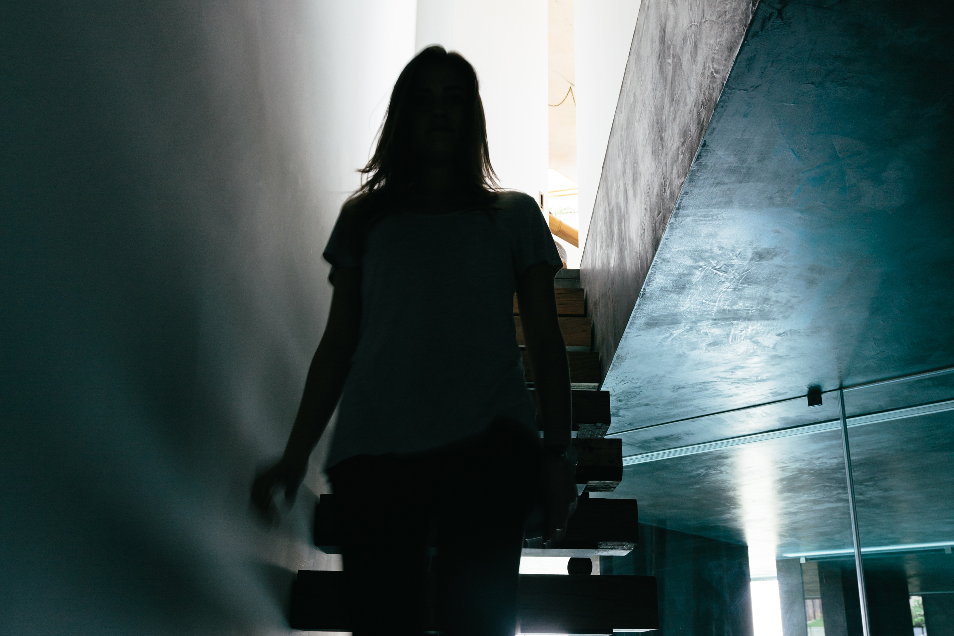 Woman walking up the basement stairs