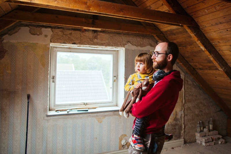 Man and daughter in an unrenovated room