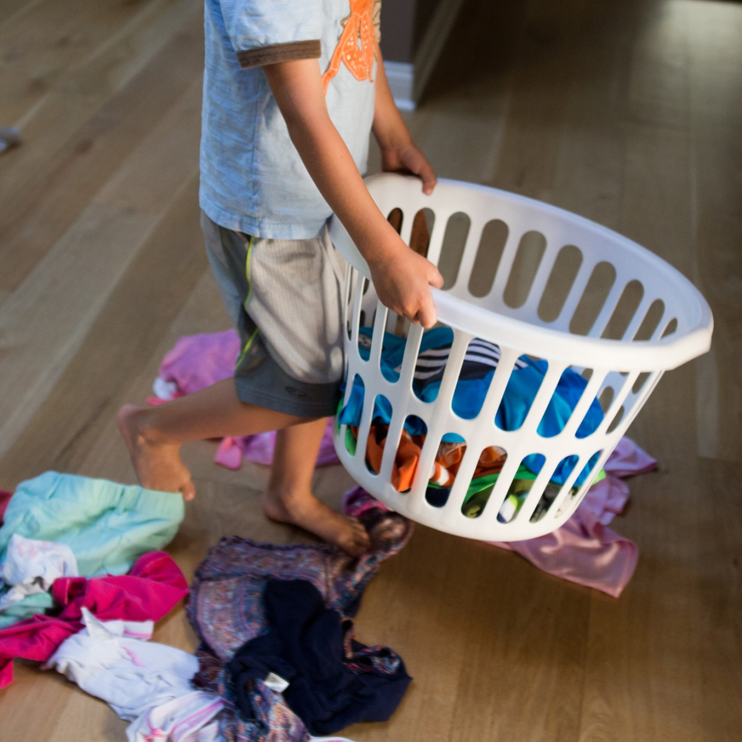 Boy carrying a basket of laundry