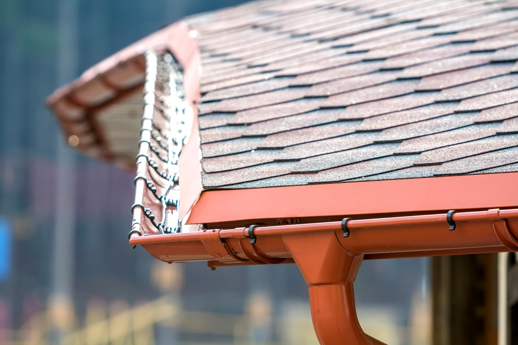 Close up of a roof with copper gutters
