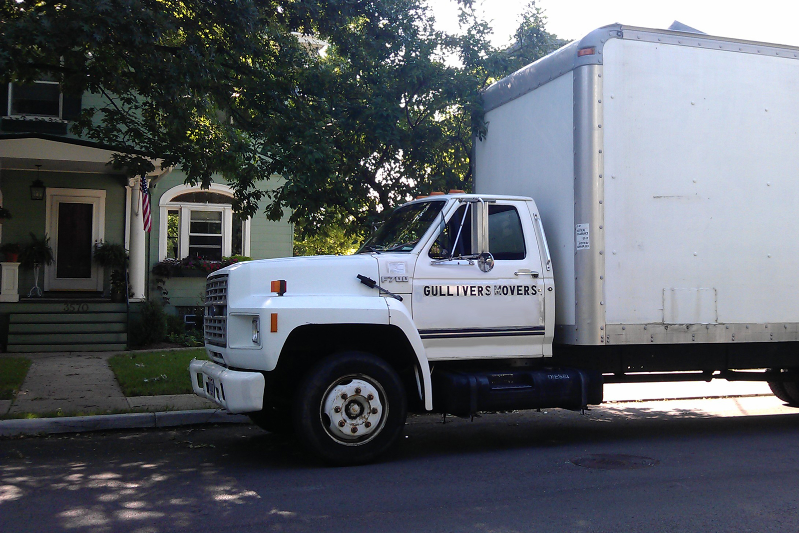 A moving van in front of a house
