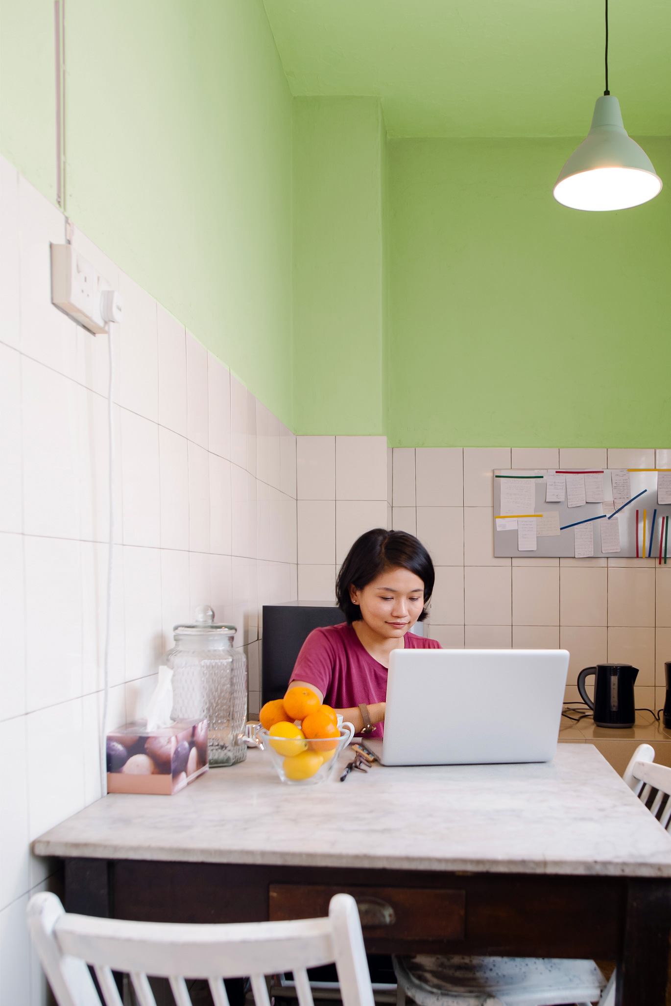 Penny-pinching woman in her kitchen