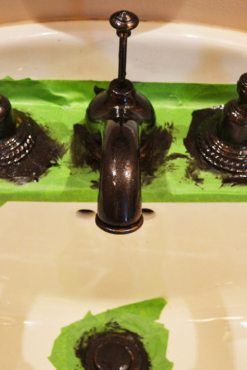 Black painted fixtures with green tape in bathroom
