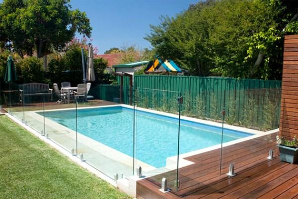 Glass fence around a home pool