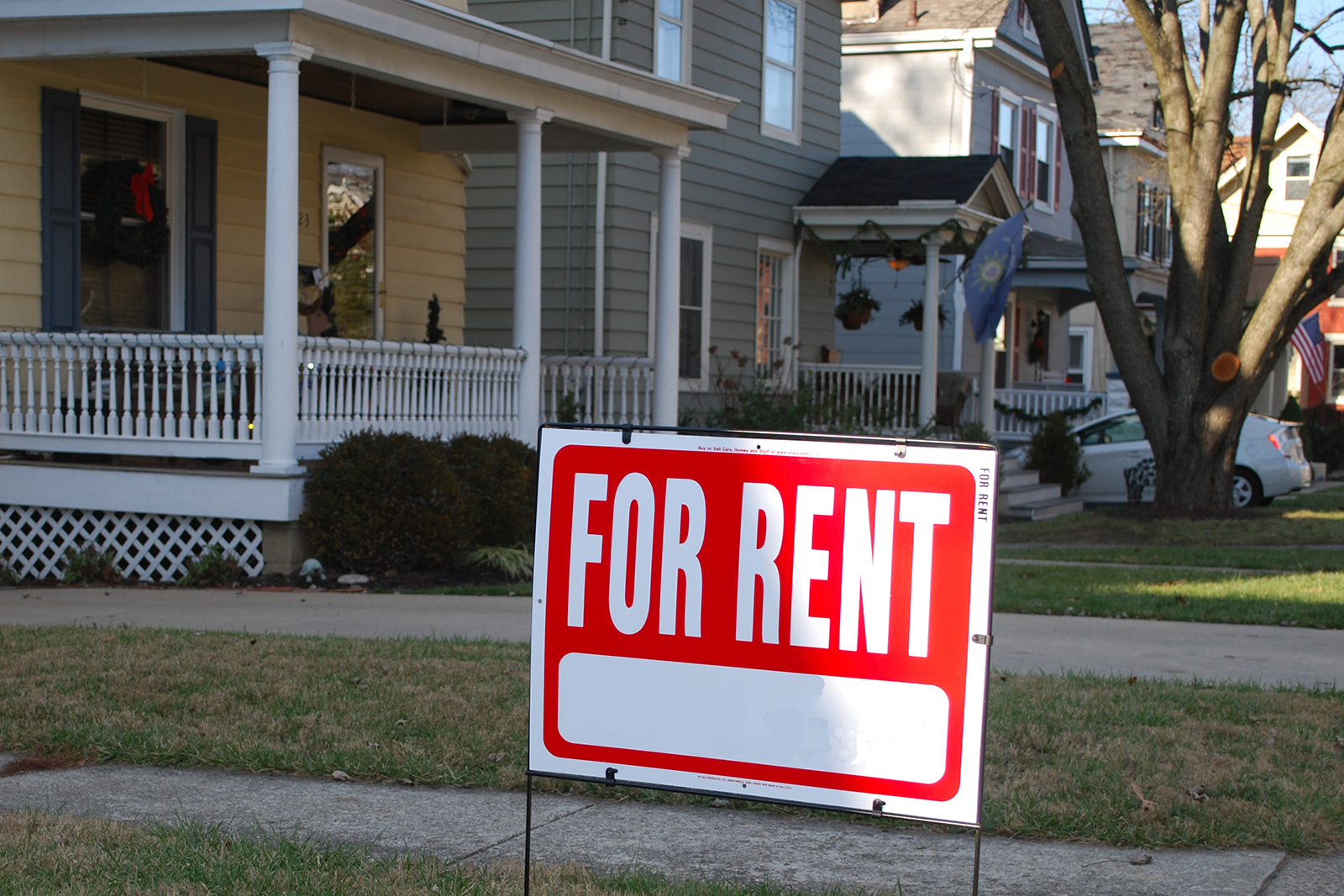 A for rent sign outside of a house